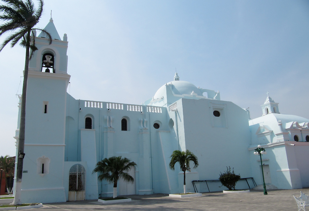 The color of the Candelaria Church in Tlacotalpan, Veracruz blends with skies above.