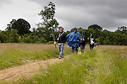 Family members walk through a meadow during a treasure hunt at the Caulfield/Mulryan family reunion at Ardenode Stud, County Kildare, Ireland on Sunday, June 23rd 2013. (Photo by Brian Garfinkel)