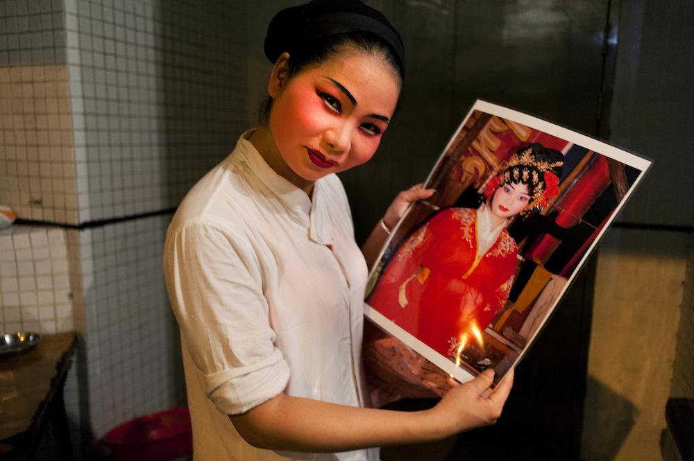 Chaozhou style opera in Shek Tong Tsui, Hong Kong. An actress shows her portrait