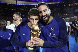 September 9, 2018 - Paris, 93, France - Benjamin Pavard, Adil Rami of France celebrate with the World Cup Trophy after the UEFA Nations League A group official match between France and Netherlands at Stade de France on September 9, 2018 in Paris, France. This is the first match of the French football team at the Stade de France since their victory in the final of the World Cup in Russia. (Credit Image: © Mehdi Taamallah/NurPhoto/ZUMA Press)
