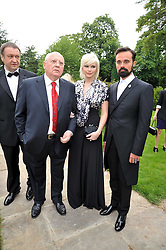 Left to right, ?, MIKHAIL GORBACHEV,  Anastasia Virganskay and EVGENY LEBEDEV  at the Raisa Gorbachev Foundation fourth annual fundraising gala dinner held at Stud House, Hampton Court, Surrey on 6th June 2009.