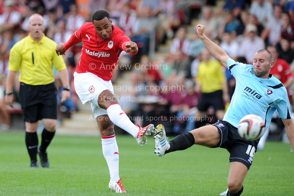 Nicky Maynard of Cardiff city has a shot at goal. Pre-season friendly football match, Cheltenham Town v Cardiff city at the Abbey Business stadium in Cheltenham, England on Sat 27th July 2013. pic by Andrew Orchard,  Andrew Orchard sports photography,