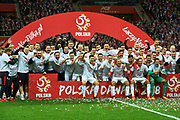 Warsaw, Poland - 2017 October 08: Robert Lewandowski of Poland celebrates with team mates promotion to the World Cup in Russia 2018 after soccer match Poland v Montenegro - FIFA 2018 World Cup Qualifier at PGE National Stadium on October 08, 2017 in Warsaw, Poland.<br /> <br /> Mandatory credit:<br /> Photo by &copy; Adam Nurkiewicz / Mediasport<br /> <br /> Adam Nurkiewicz declares that he has no rights to the image of people at the photographs of his authorship.<br /> <br /> Picture also available in RAW (NEF) or TIFF format on special request.<br /> <br /> Any editorial, commercial or promotional use requires written permission from the author of image.