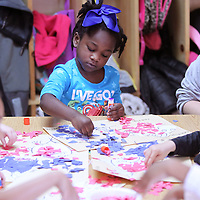 Adam Robison | BUY AT PHOTOS.DJOURNAL.COM<br /> Lauryn Ivy, 4, a student in Debra Bogan's 3-4 year old class at Kids Landing in Tupelo, works on her One Fish, Two Fish, Red Fish, Blue Fish activity Thursday morning. Kids Landing welcomed Mooreville fifth grade students that are Beta Club members to help them celebrate the Birthday of Dr. Seuss by reading and helping with craft activities as a part of Read Across America Week.