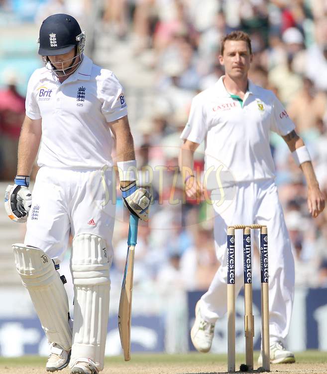 England's Ian Bell trudges away after losing his wicket to South Africa's Dale Steyn (R) - England v South Africa - 1st Investec Test Match -  Day 5 - The Oval  - London - 23/07/2012..Andrew Fosker / Seconds Left Images