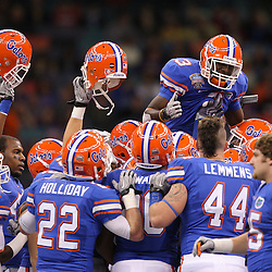 Jan 01, 2010; New Orleans, LA, USA;  Florida Gators running back Chris Rainey (3) is held up by teammates during a pregame team huddle before kickoff of the 2010 Sugar Bowl at the Louisiana Superdome.  Mandatory Credit: Derick E. Hingle-US PRESSWIRE.