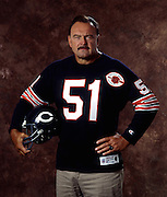 Former Chicago Bears linebacker and member of the Pro Football Hall of Fame Dick Butkus poses for a photograph wearing an NFL Chicago Bears Throwbacks jersey while holding a Bears throwbacks helmet July 8, 1993 in Los Angeles. (©Paul Anthony Spinelli)