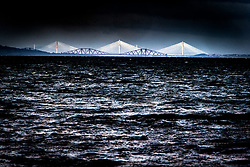 The bridges over the Firth of Forth as seen from the beach at Longniddry.