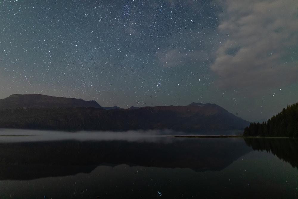 Night sky above Robe Lake in Southcentral Alaska. Autumn.