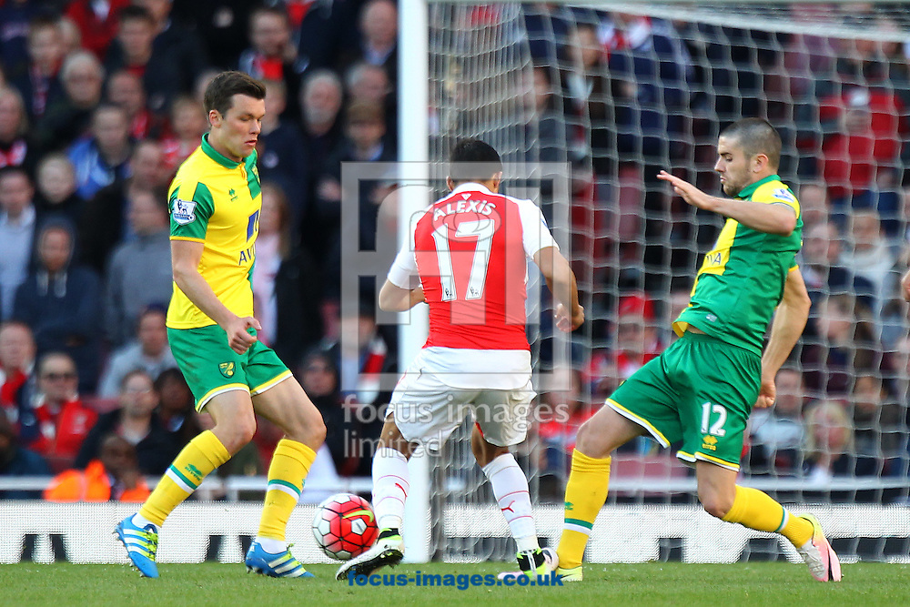 Jonny Howson of Norwich, Robbie Brady of Norwich and Alexis Sanchez of Arsenal in action during the Barclays Premier League match at the Emirates Stadium, London, UK.<br /> Picture by Paul Chesterton/Focus Images Ltd +44 7904 640267<br /> 30/04/2016