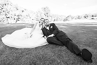 Reclining and relaxed newlyweds at the country club