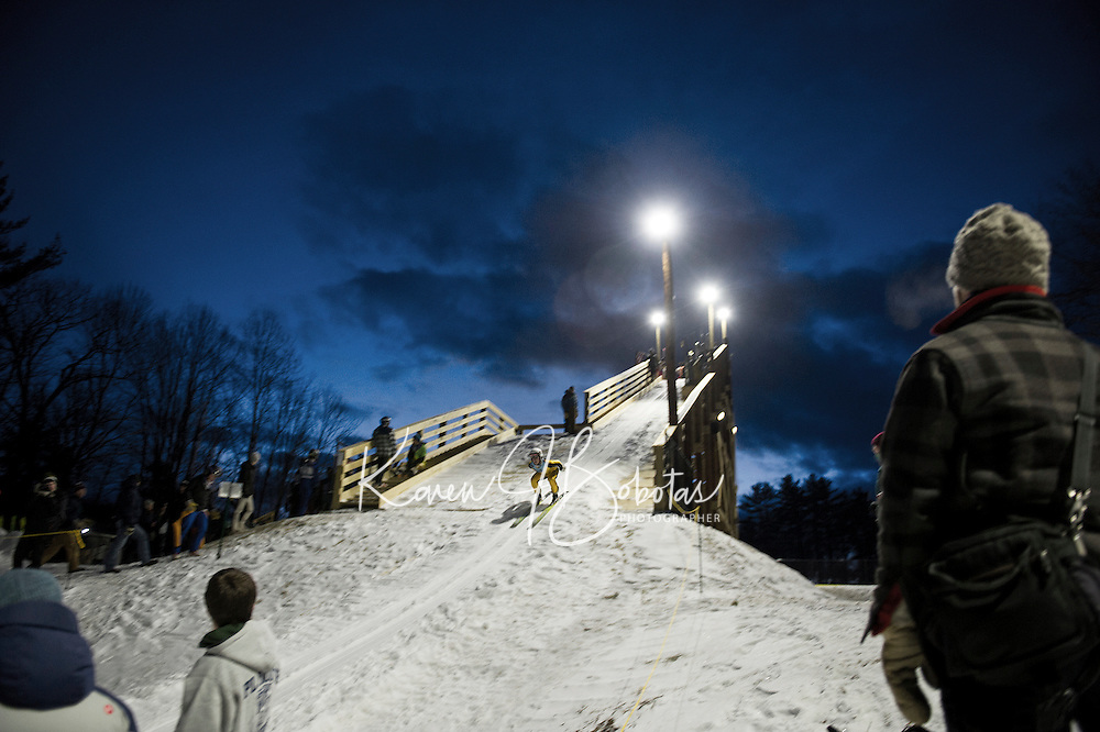 A skier goes down the inrun of the 28 meter jump during Plymouth High School's ski jump meet on Friday evening.  (Karen Bobotas/for the Laconia Daily Sun)