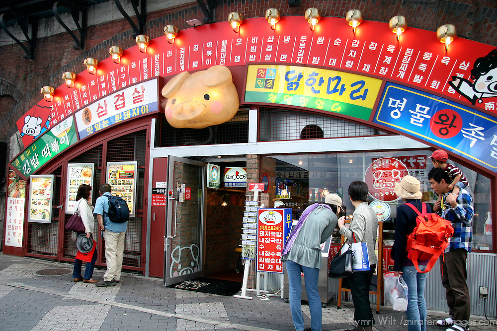 Asia, Japan, Tokyo. Typical Japanese eatery in Tokyo, where people select from pictures of the entrees outside.