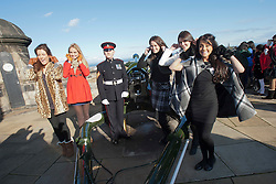Miss Scotland Jennifer Reochs after firing of the One O'clock gun with Gunner Jamie Shannon. With Miss Ireland Holly Carpenter, Miss England Alize Lily Mounter, Miss Northern Ireland Finola Frances Guinnane and Miss Wales Sara Jessica Manchipp..The Miss World participants visit Edinburgh Castle and will witness the firing of the One O'clock gun..MISS WORLD 2011 VISITS SCOTLAND..Pic © Michael Schofield.