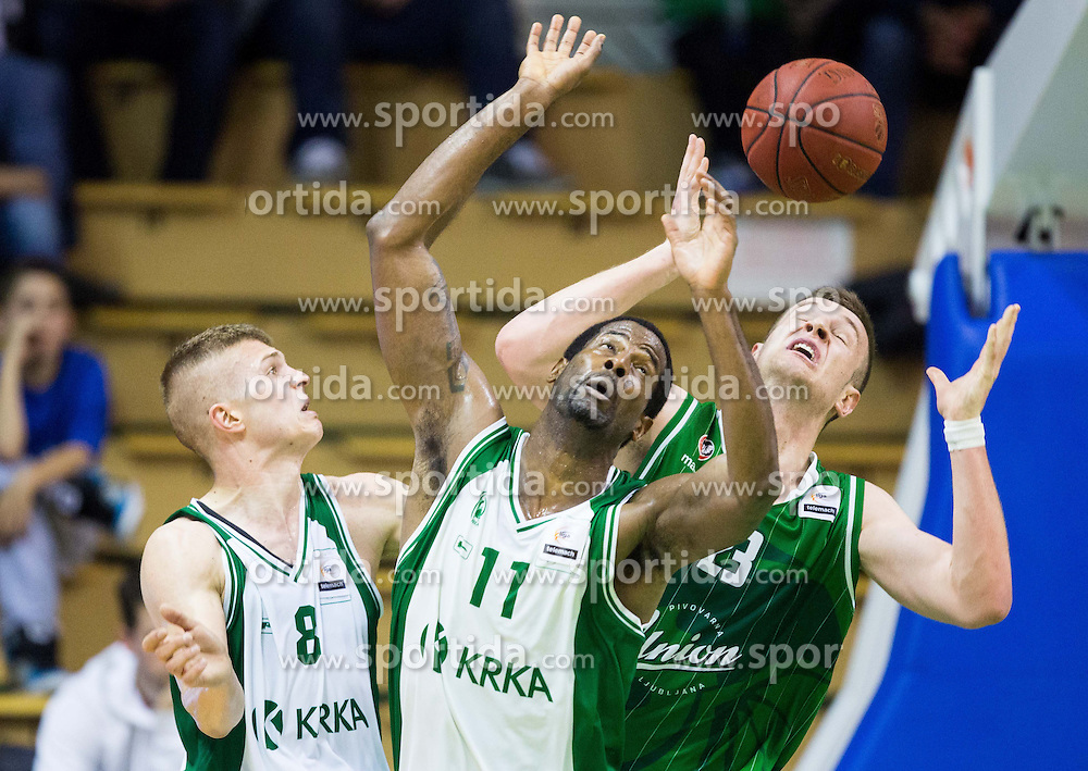 Edo Muric of Krka and Christopher Booker of Krka vs Alen Omic of Union Olimpija  during basketball match between KK Krka and KK Union Olimpija in 10th Round of Slovenian National Championship 2013/14, on April 28, 2014 in Dvorana Leona Stuklja, Novo mesto, Slovenia. Photo by Vid Ponikvar / Sportida