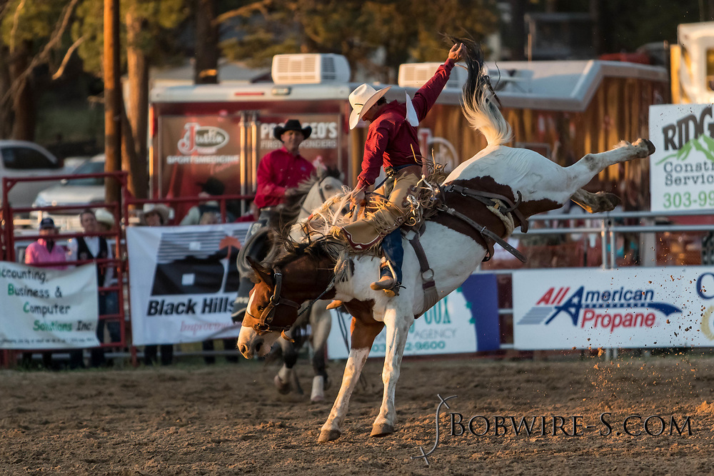 Saddle bronc rider Brady Love rides Summit Pro Rodeo's 205 in the second performance of the Elizabeth Stampede on Saturday, June 2, 2018.