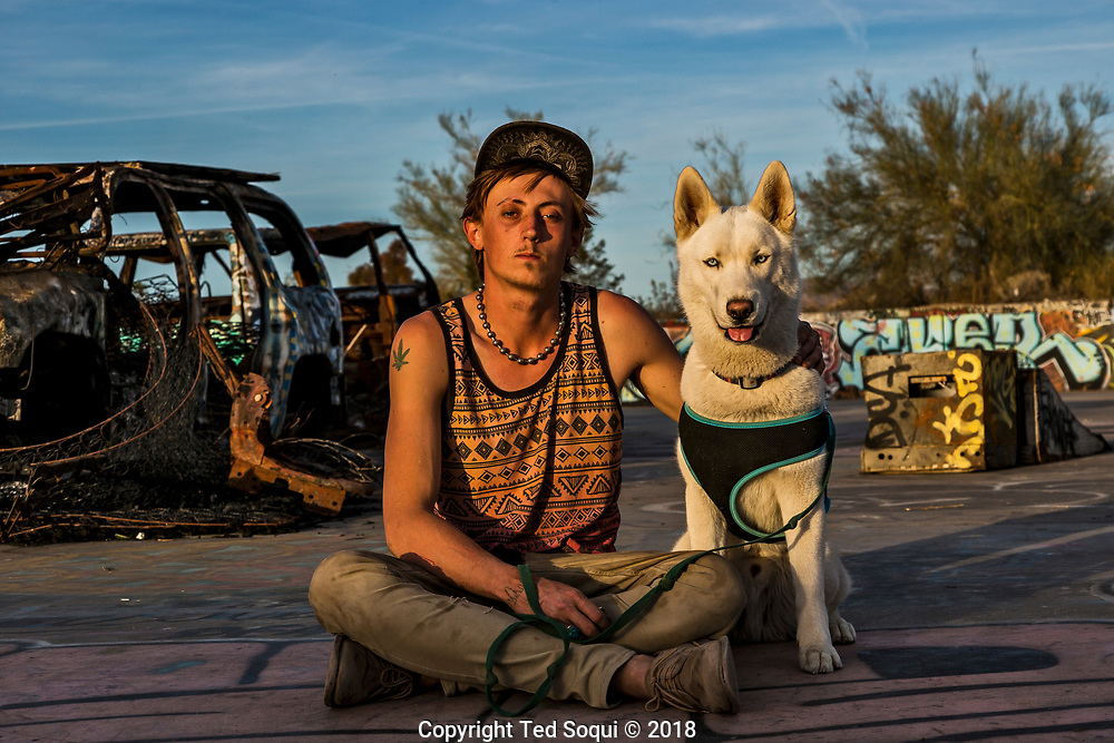 Zac and his dog Buddha inside the skatepark at Slab City.<br /> Slab City and the local environs.