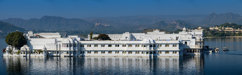 UDAIPUR, INDIA - CIRCA NOVEMBER 2016:  Panoramic view of Lake Palace Hotel formerly known as Jag Niwas in Lake Pichola in Udaipur