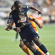 Union Attacker Danny Mwanga #10 try to keep possession of the ball while Dynamo Midfielder Adam Moffat #16 defends him from behind during Saturday MLS regular season match. The Dynamo and The Philadelphia Union played to a 1-1 tie. Saturday Aug. 6, 2011. at PPL Park in Chester PA...The News Journal/SAQUAN STIMPSON