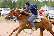 "09 SEPTEMBER 2007 -- ST. MICHAELS, AZ: JONAH BEGAY on Therapist come into the finish line at the end of a two and a half mile long race at a traditional Navajo Horse Race in the summit area of the Navajo Indian reservation about 10 miles west of St. Michaels, AZ. Traditional horse racing is making a comeback on the Navajo reservation. The races are run on improvised courses that vary depending on the local terrain. Use of saddles is optional (except in the ""Cowhand Race"" which requires a western style saddle) and many jockeys ride bareback. The distances vary from one mile to as long as thirty miles. Traditional horse races were common until the 1950's when they fell out of favor, but there has been a resurgence in traditional racing since the late 1990's and now there is a traditional horse racing circuit on the reservation. The race was organized by the Begay family of Steamboat, AZ and run on private land about three miles from a paved road. Jonah Begay won the race.  PHOTO BY JACK KURTZ"
