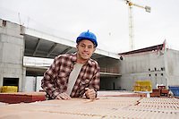 Young construction worker on building site