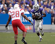 Kansas State running back Carlos Alsup (21) takes the ball up field against Illinois State's James Temple (28) at Bill Snyder Family Stadium in Manhattan, Kansas, September 2, 2006.  The Wildcats beat the Redbirds 24-23.