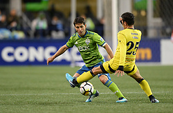 March 1, 2018 - Seattle, Washington, U.S - Soccer 2018: Sounders midfielder NICO LODEIRO (10) defends against ALDAIR RIVERA (25)  as Santa Tecla FC visits the Seattle Sounders for a CONCACAF match at Century Link Field in Seattle, WA. (Credit Image: © Jeff Halstead via ZUMA Wire)