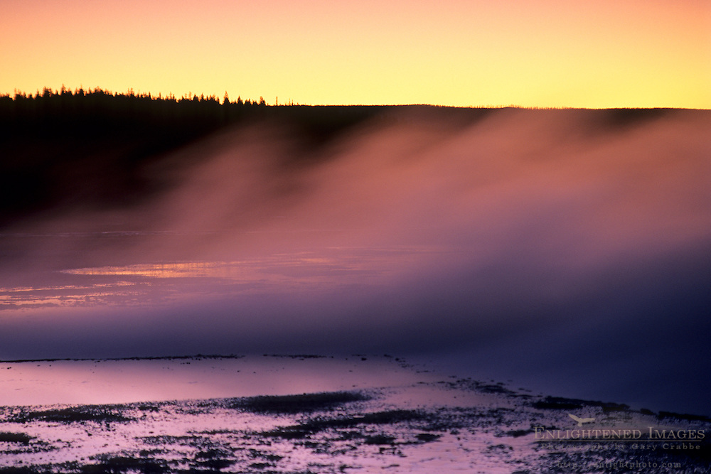 Steam from thermal hot spring rises at sunset, Fountain Paint Pot area, Yellowstone National Park, MONTANA