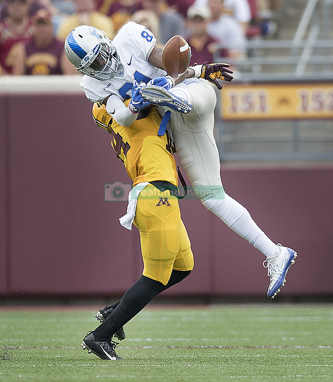 September 16, 2017 - Minneapolis, MN, USA - Minnesota defensive back Zo Craighton stops a passed intended for Middle Tennessee wide receiver CJ Windham, top, during the second quarter at TCF Bank Stadium, Saturday, Sept. 16, 2017, in Minneapolis. The host Gophers won, 34-3. (Credit Image: © Elizabeth Flores/TNS via ZUMA Wire)