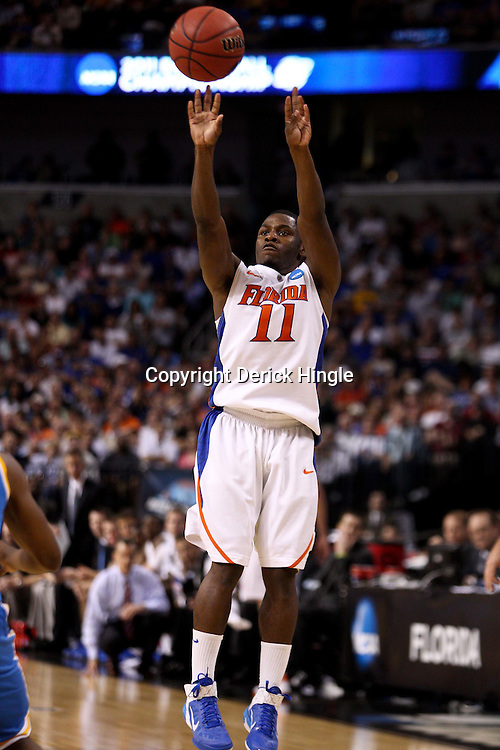 Mar 19, 2011; Tampa, FL, USA; Florida Gators guard Erving Walker (11) shoots against the UCLA Bruins during first half of the third round of the 2011 NCAA men's basketball tournament at the St. Pete Times Forum.  Mandatory Credit: Derick E. Hingle