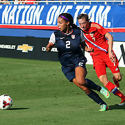 U.S. forward Sydney Leroux (2) dribbles past Russia defender Ekaterina Dmitrenko (7) during an international friendly soccer match between the United States Women's National soccer team and the Russia National soccer team at FAU Stadium on Saturday, February 8, in Boca Raton, Florida. (AP Photo/Alex Menendez)