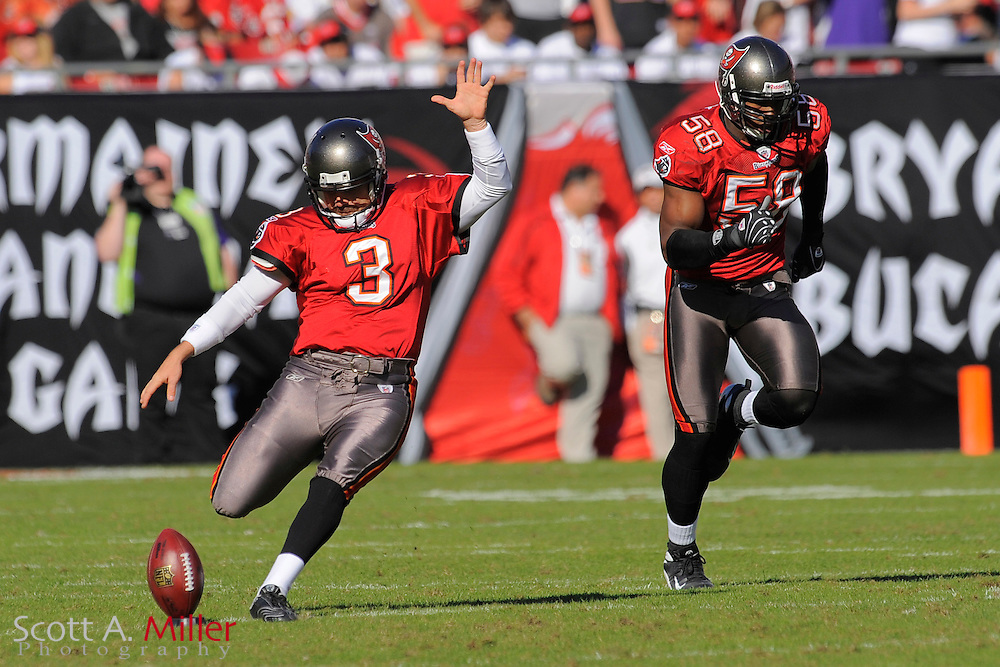 Nov. 16, 2008; Tampa, FL, USA; Tampa Bay Buccaneers kicker Matt Bryant (3) and linebacker Quincy Black (58)during the Bucs game against the Minnesota Vikings at Raymond James Stadium. The Bucs won 19-13. ...©2008 Scott A. Miller