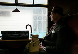 © Licensed to London News Pictures. <br /> 15/10/2016. <br /> Grosmont, UK.  <br /> <br /> A man dressed in 1940's clothing sits in a carriage waiting to leave Grosmont station during the North Yorkshire Moors Railway Wartime Weekend event. <br /> The annual event brings together re-enactors and enthusiasts along the length of the NYMR heritage steam railway line to recreate the feel of the war years of the 1940's. <br /> <br /> Photo credit: Ian Forsyth/LNP