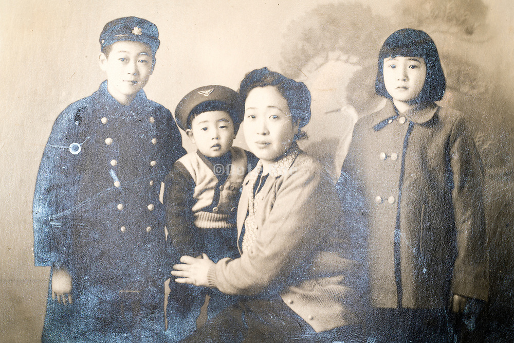 deteriorating family group studio portrait Japan ca 1940s 1950s