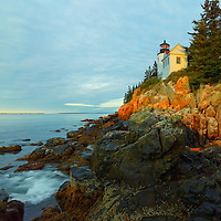 Bass Harbour Head lighthouse at sunrise in Acadia National Park Maine.