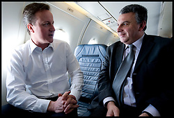 Leader of the Conservative Party David Cameron with the Political Editor of the Sunday Telegraph on a flight back from Scotland to London during his General Election campaign, Friday April 9, 2010. . Photo By Andrew Parsons / i-Images.