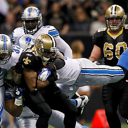 January 7, 2012; New Orleans, LA, USA; New Orleans Saints running back Pierre Thomas (23) is tackled by Detroit Lions defenders during the 2011 NFC wild card playoff game at the Mercedes-Benz Superdome. Mandatory Credit: Derick E. Hingle-US PRESSWIRE