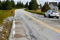 Stones litter road after being thrown up by waves by Hurricane Dorian Cherry Hill, Nova Scotia, Canada