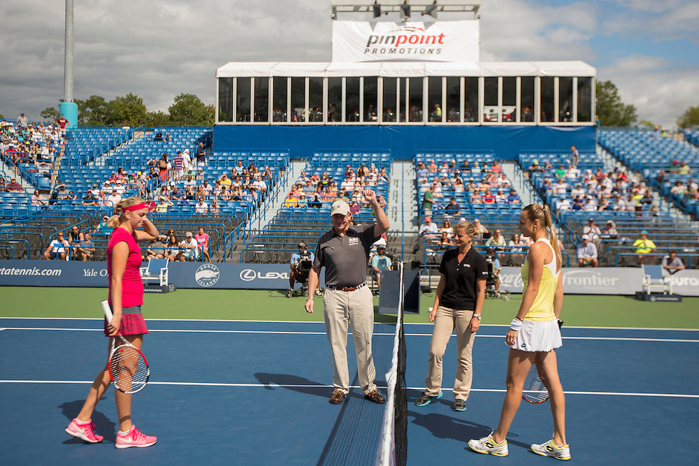 August 23, 2014, New Haven, CT:<br /> Magdalena Rybarikova and Petra Kvitova participate in a coin toss with Charlie Gill of United Technologies before the singles final on day nine of the 2014 Connecticut Open at the Yale University Tennis Center in New Haven, Connecticut Saturday, August 23, 2014.<br /> (Photo by Billie Weiss/Connecticut Open)