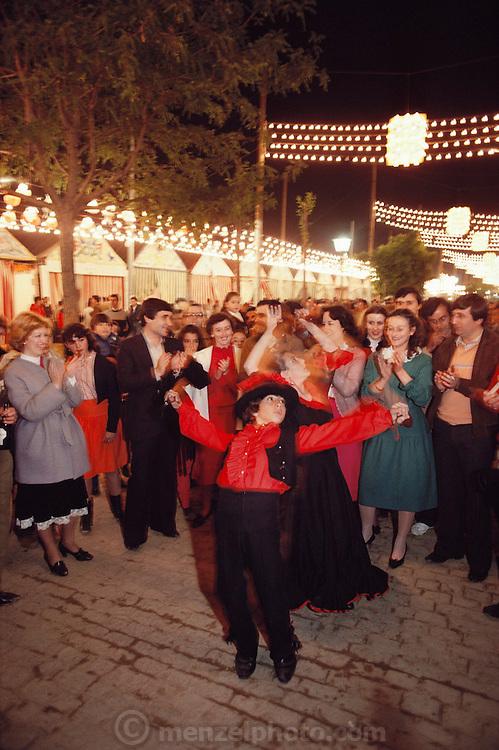 Flamenco in the street during April Fair Seville, Spain.