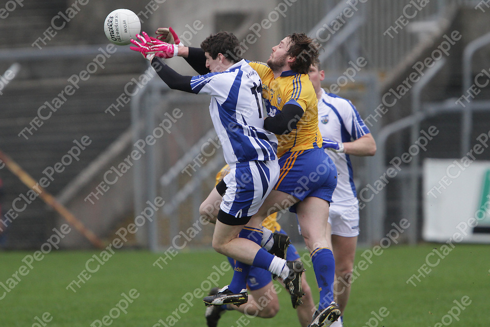 Clare's John Hayes punches the ball away from the grasp of Waterford's Robert Ahearne in their Division 4 clash @ Cusack Park. - Photograph by Flann Howard