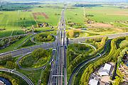 Nederland, Zuid-Holland, Gorinchem, 09-05-2013; knooppunt Gorinchem, kruising rijksweg A27 met A15 (vlnr). Foto van  het klaverblad in de richting Utrecht, langs de A27.<br /> Junction motorway A27 with A15, Cloverleaf Gorinchem<br /> luchtfoto (toeslag op standard tarieven)<br /> aerial photo (additional fee required)<br /> copyright foto/photo Siebe Swart