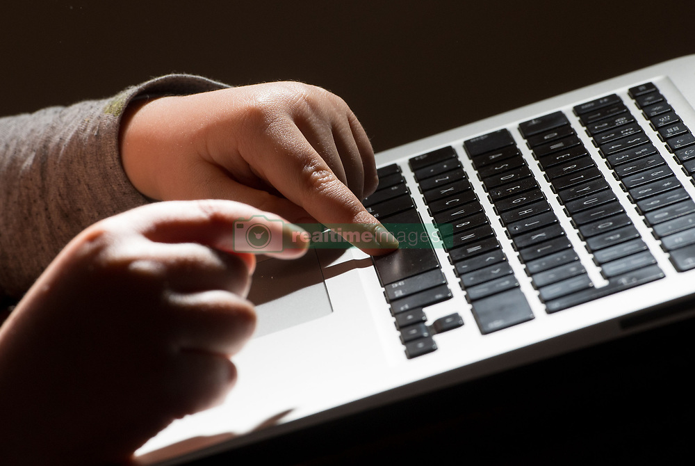 Embargoed to 0001 Wednesday June 21 File photo dated 4/3/2017 of a child's hands on the keys of a laptop keyboard. Young people need to be taught cyber resilience in schools because they do not feel equipped to navigate the online world, a charity has warned.