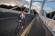 Cycle for freedom entrants pass over Albert Bridge, London, 20 Oct 2014. Guy Bell, 07771 786236, guy@gbphotos.com