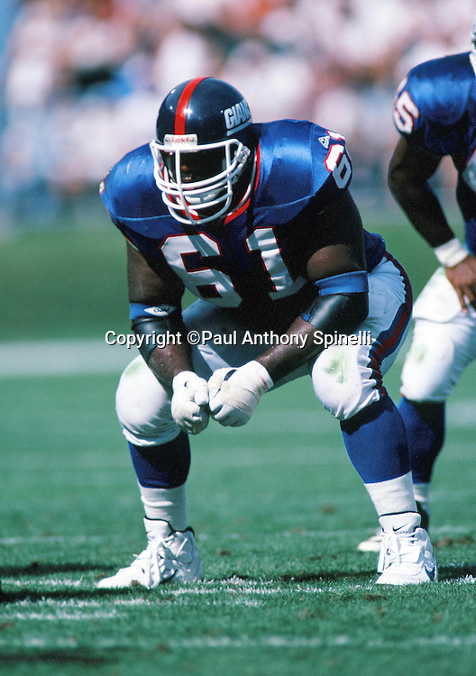 An unidentified New York Giants lineman gets set for the snap during the NFL preseason football game against the Cleveland Browns on Aug. 6, 1995 in Cleveland. The Giants won the game 19-13. (©Paul Anthony Spinelli)