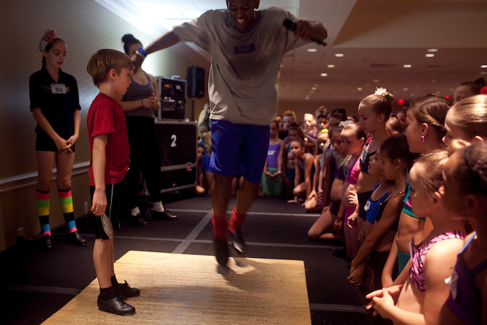 New York, NY - July 05, 2013 : Dance instructor Jared Grimes, center, shows 10-year-old tap dancer Luke Spring, left, some steps during the Mini Jazz Class at the New York City Dance Alliance National Summer Workshop held at the Sheraton New York Times Square Hotel in New York, NY on  July 05, 2013. Luke Spring, a dance prodigy from Studio Bleu Dance Center in Ashburn, VA, has performed on the Tonys, Ellen, So You Think You Can Dance and The Ford Gala. His sisters Cami Spring, 20, and Lucy Spring, 18, are both award winning dancers. (Photo by Melanie Burford/Prime for The Washington Post)