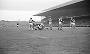 Galway's M. Mc Donnagh is brought to the ground by a Kerry back during the All Ireland Senior Gaelic Football Final Kerry v. Galway in Croke Park on the 26th September 1965. Galway 0-12 Kerry 0-09.