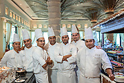 DUBAI, UAE - DECEMBER 18, 2015: The chefs at the Arboretum restaurant located in Jumeirah Al Qasr, Madinat Jumeirah Resort. The restaurant offers a wide variety of international food.