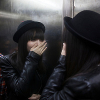 BEIJING, NOVEMBER -24 : a young woman  leaves an underground lesbian club in Beijing after a long night out.