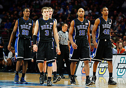 Nov 21, 2008; New York, NY, USA; (L to R) Duke Blue Devils guard Elliot Williams (20), Duke Blue Devils guard Greg Paulus (3), Duke Blue Devils forward Kyle Singler (12), Duke Blue Devils forward Gerald Henderson (15) and Duke Blue Devils forward Lance Thomas (42) head back to the court after a timeout during the 2K Sports Classic Championship game at Madison Square Garden.